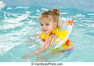 Four-year girl floating in the pool
