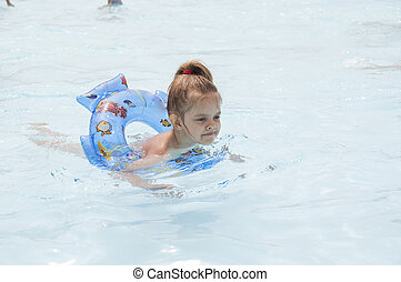 Four-year-old girl swimming in the