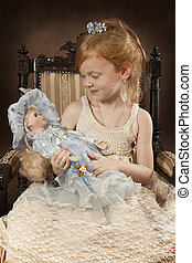 Four years old girl with a doll