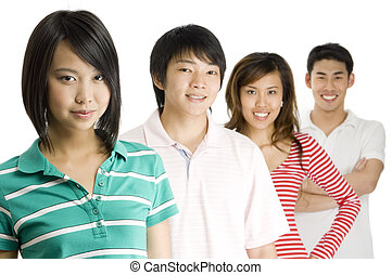Four young asian men and women standing in a row (Shallow depth of field used)