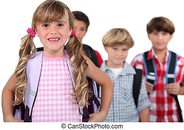 Four young children with backpacks