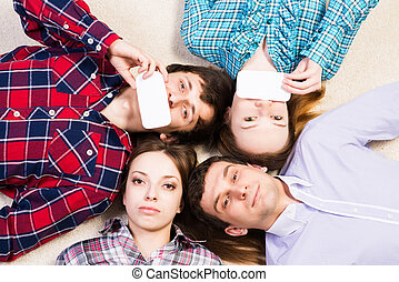 four young men lie together