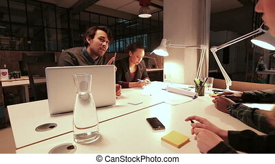 Creative people discussing work