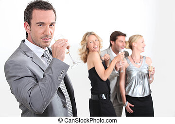 Four young professionals drinking champagne