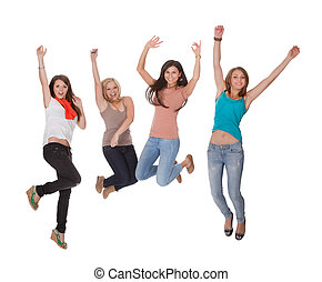 Four young woman jumping for joy - Four excited young woman...