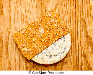 Fourme d'Ambert French chees with slice of delicious crispread