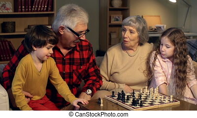 Foursome Chess Play - Grandparents teaching children to play...