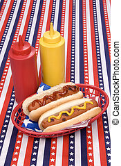 Fourth of July hotgogs with ketchup and mustard - A...