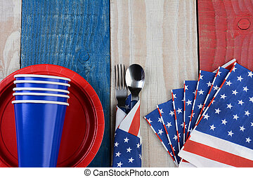 Fourth of July Picnic Table Setting - High angle photo of a...