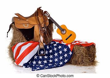 Fourth of July saddle and flag - Riding saddle on hay,...