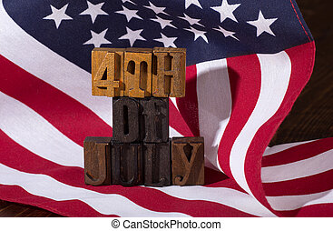 Fourth of July Sign and the American Flag