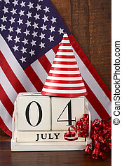 Fourth of July vintage wood calendar with flag background.