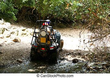 Fourwheeler crossing water stream - Young couple seeking way...