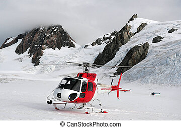 FOX GLACIER, NZ - MAR 07:Two Helicopters on top of Fox Glacier on March 07 2009,NZ.It's a 13 km (8.1 mi) long glacier located in Westland National Park on the West Coast of New Zealand's South Island