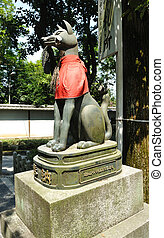 Fox statue at the Fushimi Inari shrine in Kyoto, Japan.