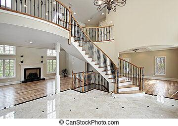 Foyer and circular staircase - Foyer with curved staircase...