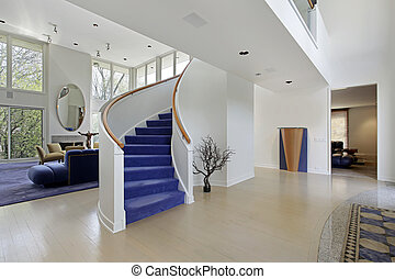 Foyer in modern home with purple carpeted stairs