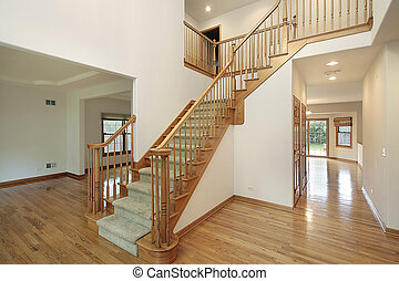 Foyer in new construction home with dining room view