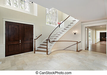 Foyer with circular staircase - Foyer in new construction ...