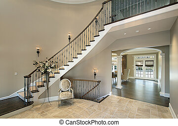 Foyer in luxury home with curved staircase