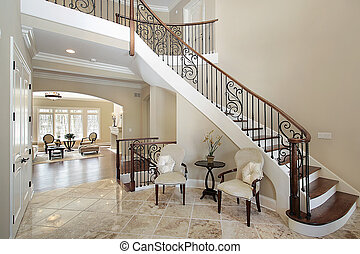 Foyer with curved staircase in luxury home