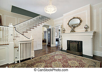 Foyer with fireplace mirror and stairway