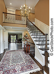 Foyer in suburban home with gold walls