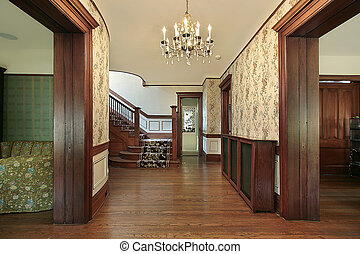 Foyer with wood paneling - Foyer in older home with wood...