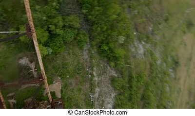 FPV drone flies quickly and maneuverable near abandoned huge...
