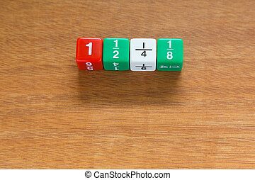 Fracetion dices line up on wood table
