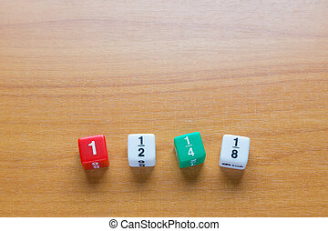 Fraction dices on wood table