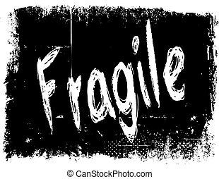FRAGILE on black grunge background.