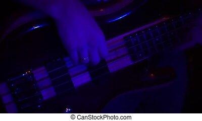 Fragment e-guitar and hand closeup