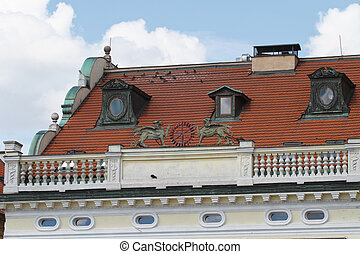 Fragment of a building in Prague with a parapet close up. details