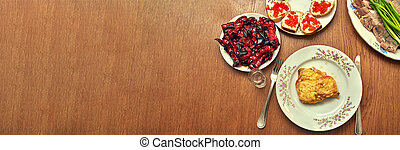 Fragment of a festive table with food, top view, copy space and Mock up