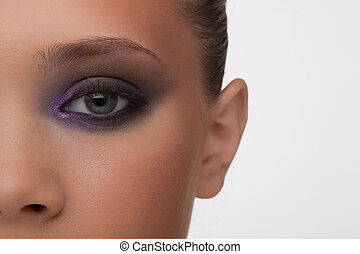 Fragment of a fine woman's face in a fashionable make-up profess