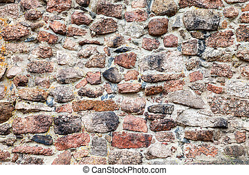 Fragment of a natural old stone wall as background
