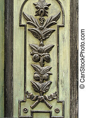 Fragment of a pattern on an old wooden door