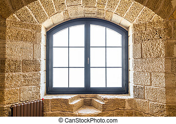 Fragment of a stone wall with a window