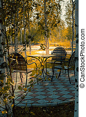 Fragment of a summer cafe in the city park