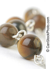Necklace - Fragment of an Brown Necklace with Wooden Beads...