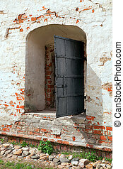 Fragment of an old wall with a window