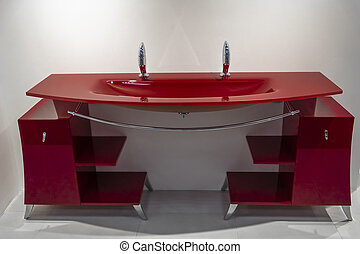 Fragment of bathroom with a red furniture
