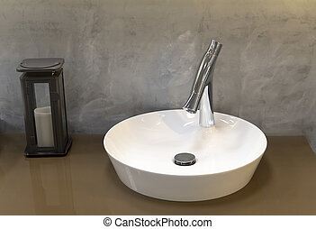 Fragment of bathroom with sink and faucet