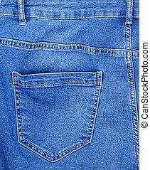 fragment of blue jeans with back pocket