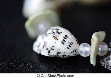 Fragment of bracelet made of shells closeup