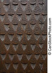 Fragment of carved brown door