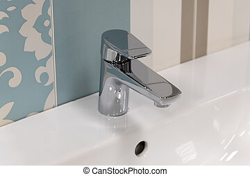 Fragment of conventional faucet in the bathroom