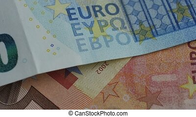 Fragment of euros banknotes. Abstract background. Close up....