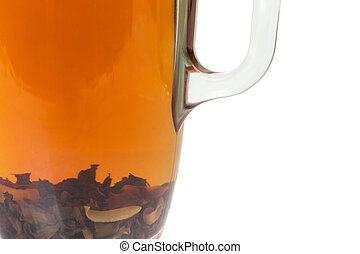Fragment of glass cup of prepared aromatic black tea